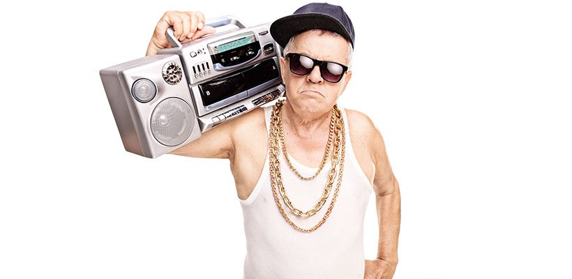 Serious senior rapper holding a ghetto blaster